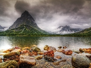 Stones, mountains, lake